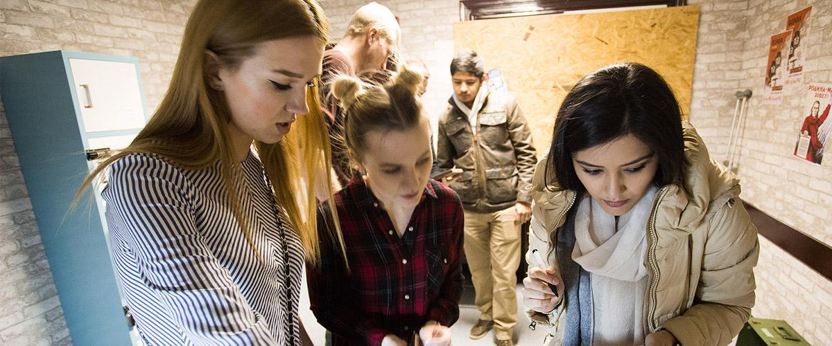 friends solving escape room puzzles