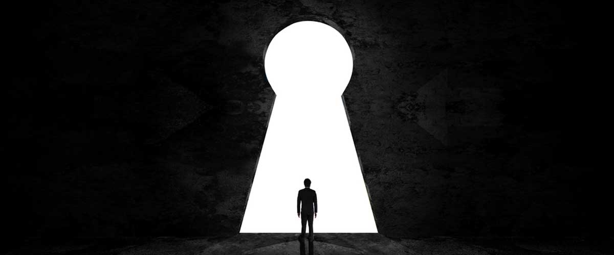 Lone man silhouette in a keyhole