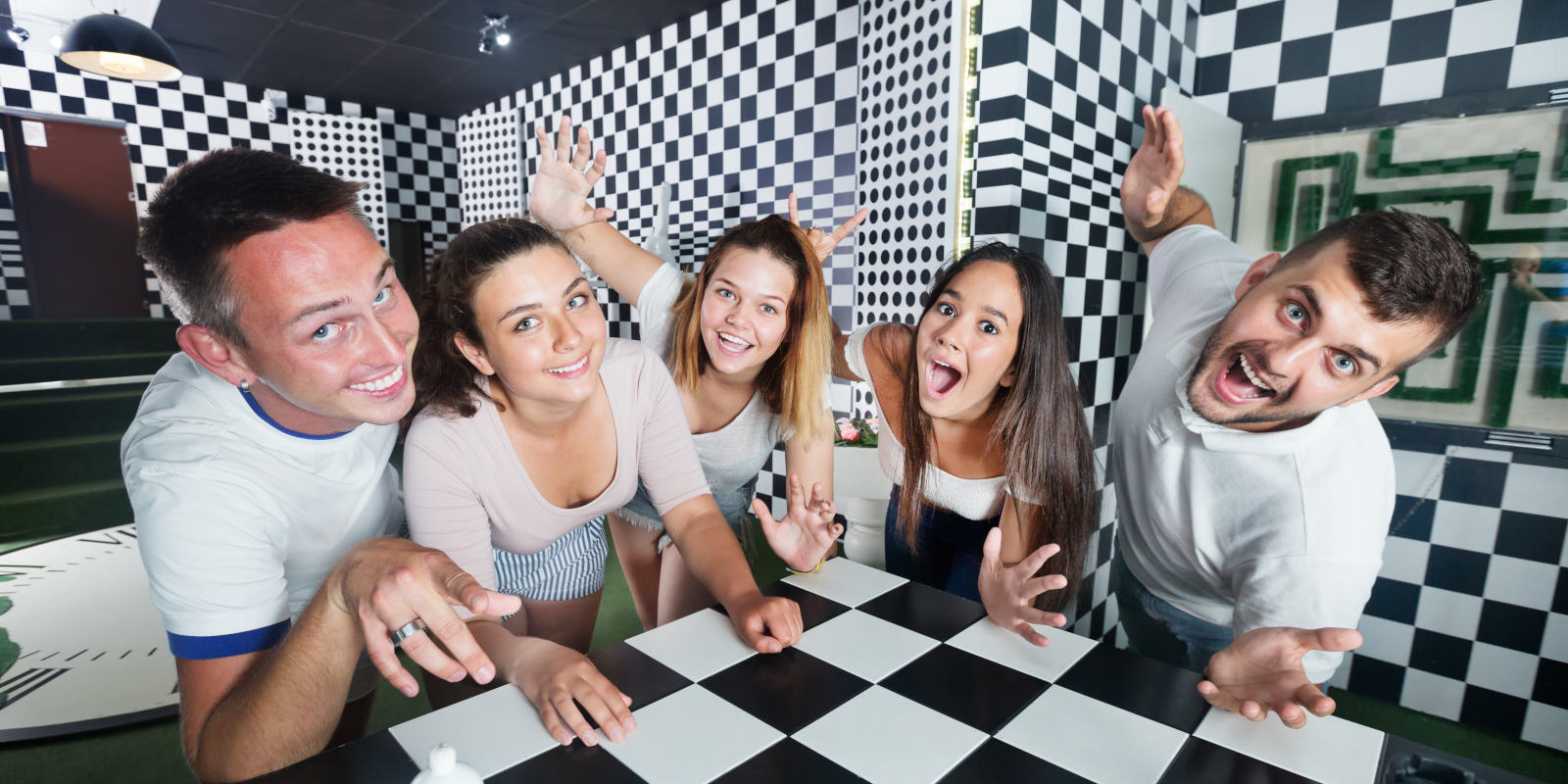 a group of work colleagues in an escape room participating in a corporate event